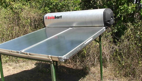 A solar water heater stands outside, and a sign instructs... Stock Video Footage