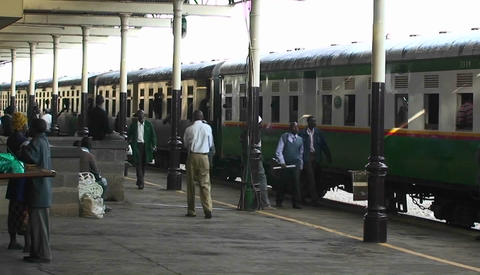 People walk along side of a train in a station Stock Video Footage