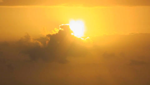 A passing cloud partially eclipses the bright sun Stock Video Footage