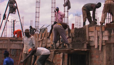 Workers transport building materials from the ground to the roof Footage