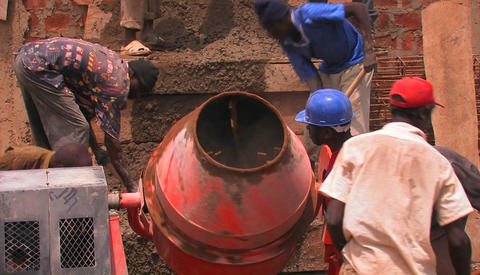 Construction workers mix cement for a building project Stock Video Footage