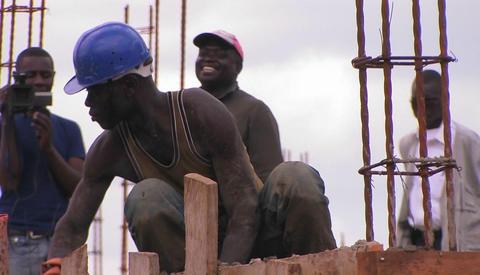 Men work on a construction job Stock Video Footage