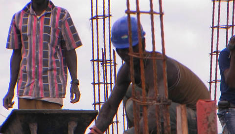 Men work on a construction job Footage