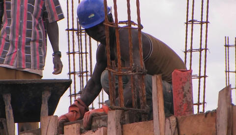 Men work on a construction job Stock Video Footage