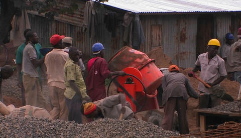 Men on a work site shovel and mix cement Footage