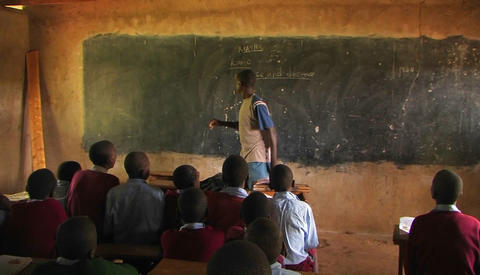 One of the boys from the class gives instruction to the... Stock Video Footage