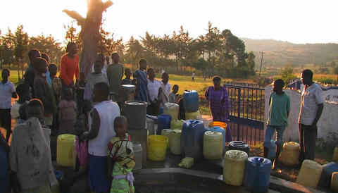 People filling up canisters with water from a water pump Stock Video Footage
