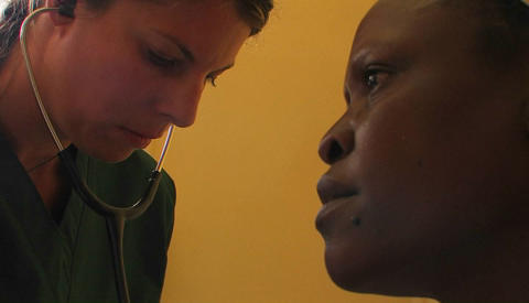 Doctor checking an African patient's breathing Stock Video Footage