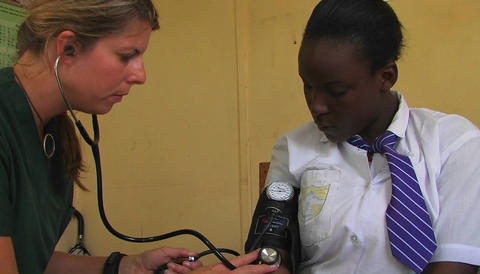 A doctor checking patient's blood pressure Footage