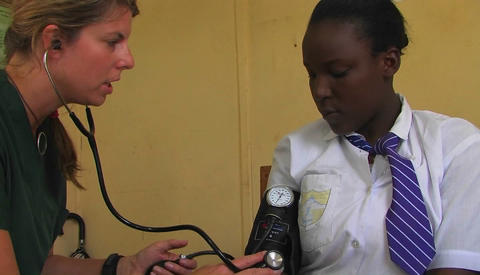 A doctor checking patient's blood pressure Stock Video Footage