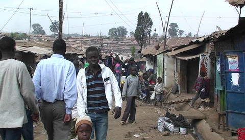 People walking in a crowded slum in Africa Stock Video Footage