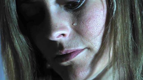 A teardrop falls down a woman's face Stock Video Footage