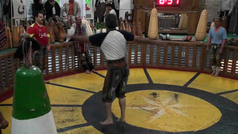 A man spinning in a circle demonstrates the traditional... Stock Video Footage
