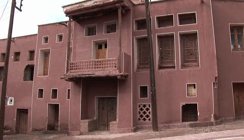 A red, traditional style building in Iran Footage