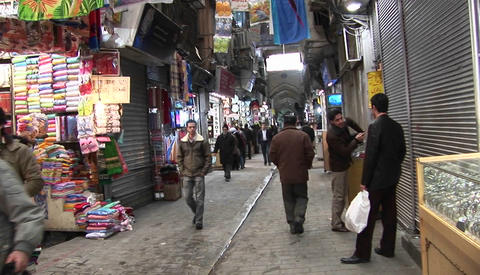 A shoppers pass through a bazaar in Iran Footage