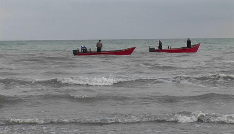 Fishermen on motor boats off the coast of Iran Stock Video Footage