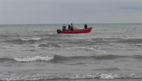 Fishermen on motor boats off the coast of Iran Stock Video Footage