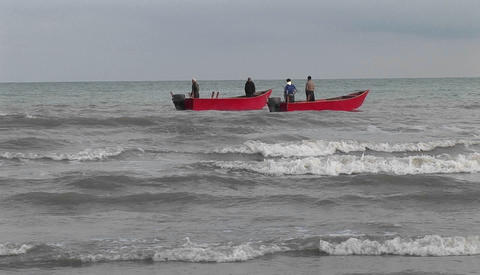 Fishermen on motor boats off the coast of Iran Footage