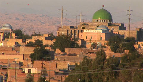 A city in Iran featuring a building with a green dome Stock Video Footage