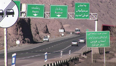 Cars pass along a highway in Iran Stock Video Footage