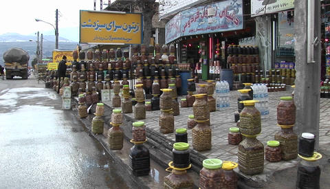 Covered cisterns outside a shop in Iran Stock Video Footage