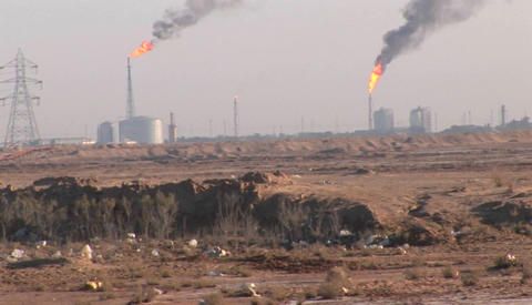 Burning extraction wells in an oil or natural gas field... Stock Video Footage