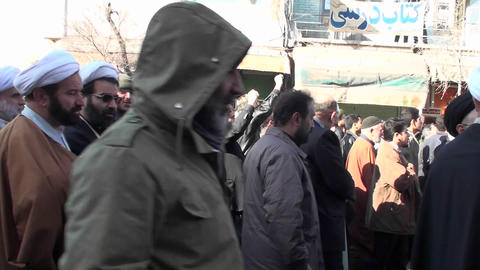 Protesters march down a busy street in Iran Footage