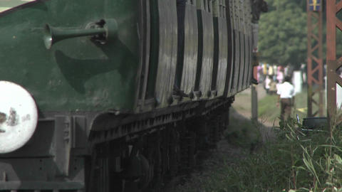 A fast approaching train travels through the country side Footage