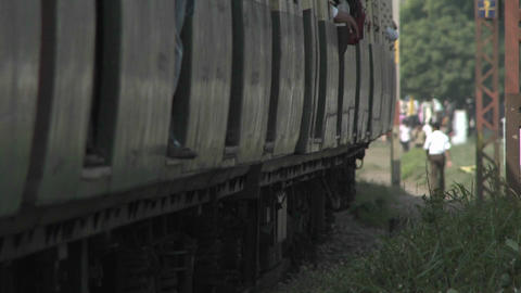 A fast approaching train travels through the country side Stock Video Footage