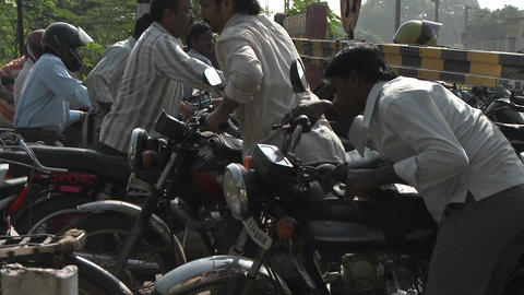 Many people mount motorcycles and ride off Stock Video Footage