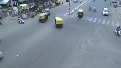 Traffic in a busy intersection in a city in India goes by in time lapse Footage