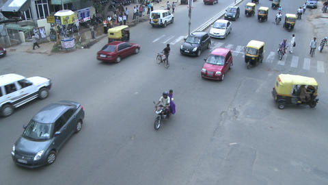 Traffic in a busy intersection in a city in India goes by... Stock Video Footage