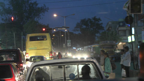Hectic traffic at night in a city in India Footage