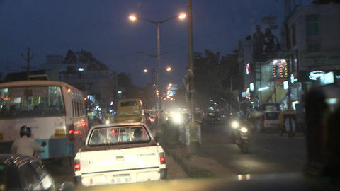 Hectic traffic at night in a city in India Stock Video Footage
