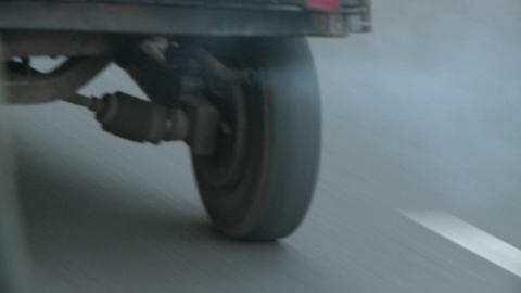 Exhaust from a vehicle on a road in India Stock Video Footage