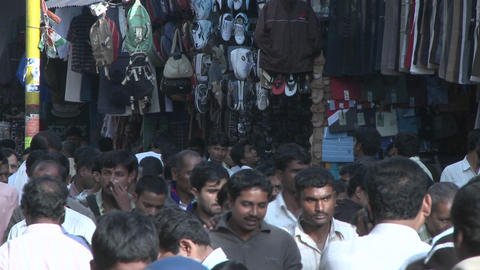 People walk through an outdoor marketplace Stock Video Footage