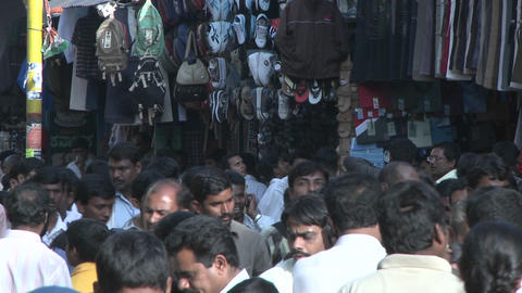 People walk through an outdoor marketplace Footage