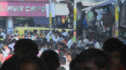 People are walking down an extremely crowded street Stock Video Footage