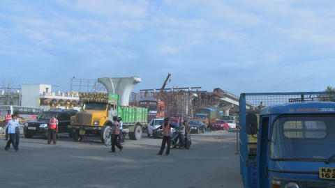 Widening view of construction workers and the traffic and... Stock Video Footage