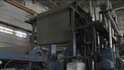 Mechanized wheels inside of a factory are turning Stock Video Footage
