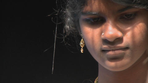 A young Hindu woman speaks to someone next to her Stock Video Footage