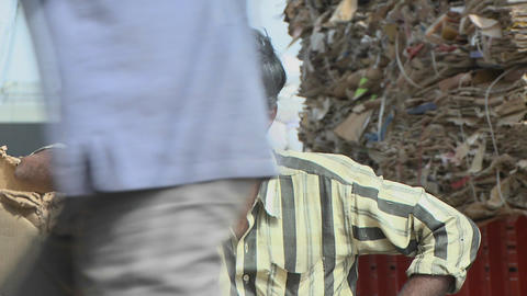Man leaning on box at a recycling center Stock Video Footage