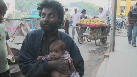 People on an Indian street watch something above their... Stock Video Footage