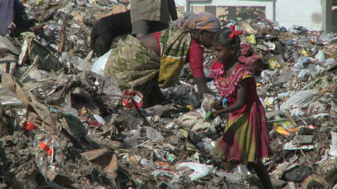 People scavenge through rubbish Stock Video Footage
