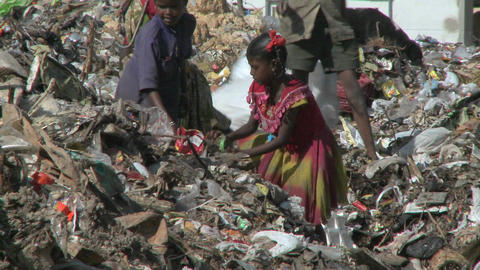 People scavenge through rubbish Footage