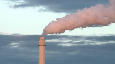 Flue gas from a chimney in a power plant. The movement of the gas and the clouds in the background c Footage