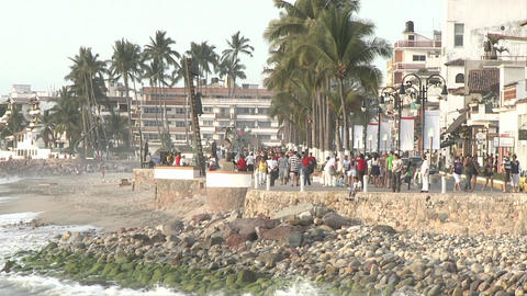 Malecon in Puerto Vallarta, Mexico, timelapse. We see the sculptures on the beach walk, palms shakin Footage