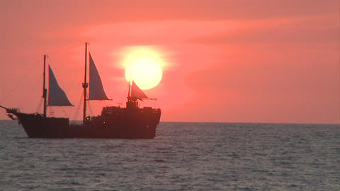 Marigalante ship in the distance while the sun sets in... Stock Video Footage