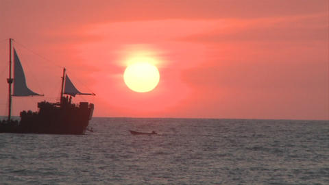 Marigalante Ship In The Distance While The Sun Sets In Malecon In Puerto Vallarta, Mexico. Orange Sk stock footage
