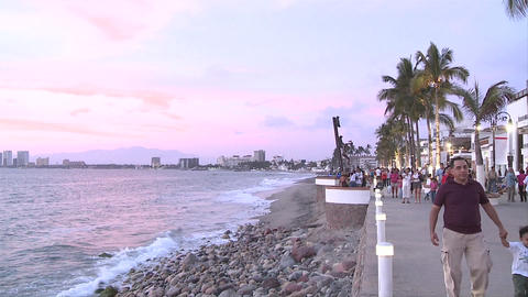 Malecon in Puerto Vallarta, Mexico. We see the sculptures on the beach walk, the tourism resort buil Footage